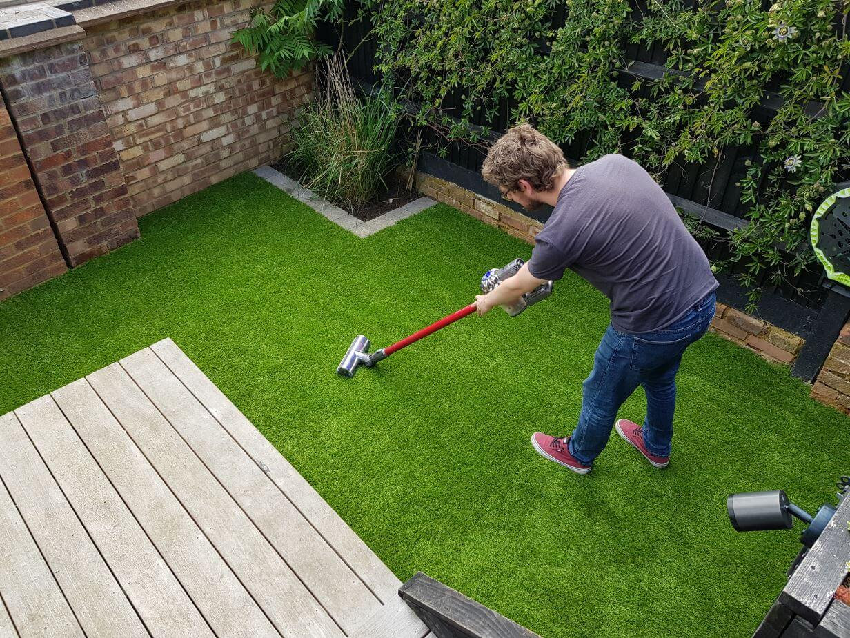 Review-Installing-Artificial-Grass-In-Our-Garden-With-Carpetright-vacuuming-fake-grass